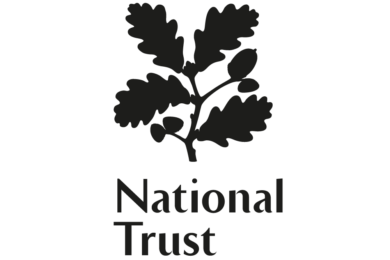 "The logo of The National Trust, a UK Charity ""working to preserve and protect historic places and spaces—for ever, for everyone"""
