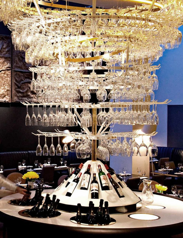Chandelier made of glasses at Avenue, London. Interiors designed by Russell Sage Studio Ltd.