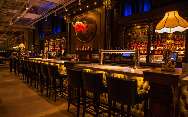 The bar at Bounce Chicago, USA. Interiors designed by Russell Sage Studio Ltd.
