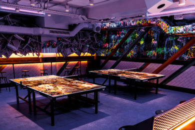 UV lighting and graffiti at Bounce Shoreditch, London. Interiors designed by Russell Sage Studio Ltd.
