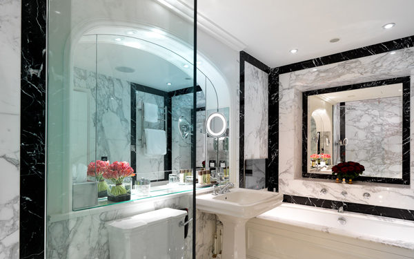 A marble bathroom at The Goring Hotel, London. Interiors designed by Russell Sage Studio Ltd.