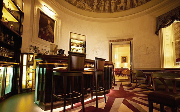 A circular bar area in The Lansdowne Club. Interiors designed by Russell Sage Studio Ltd.
