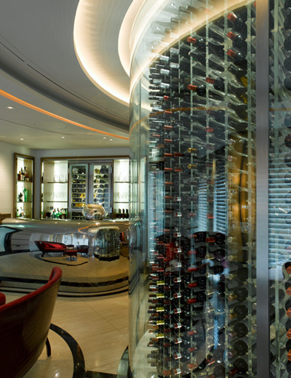 A glass wall contains hundreds of bottles of wine at Petrus, London. Interiors designed by Russell Sage Studio Ltd.