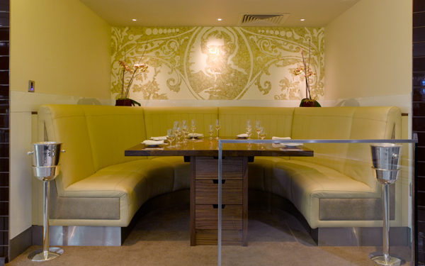 Banquette seating at Gordon Ramsay's Petrus, London. Interiors designed by Russell Sage Studio Ltd.