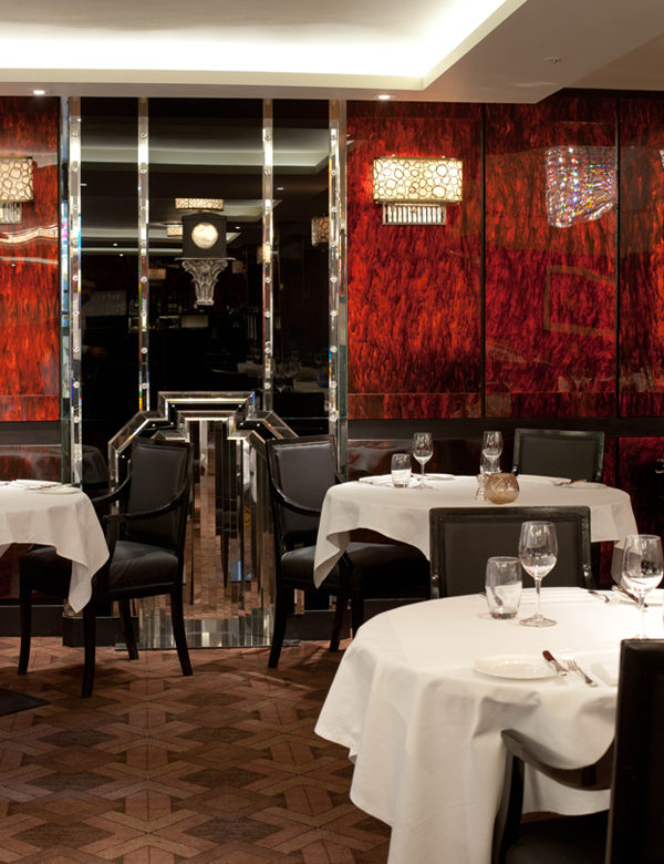 The dining room at The Savoy Grill, in London's Strand. Interiors designed by Russell Sage Studio Ltd.