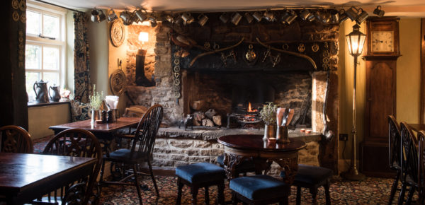 Magnificent fireplace at The Bull. Interiors designed by Russell Sage Studio Ltd.