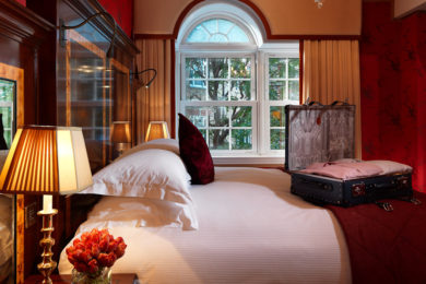 A sumptuous bedroom at The Goring Hotel, London. Interiors designed by Russell Sage Studio Ltd.